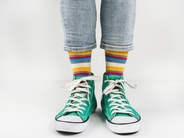 Stylish sneakers and funny, happy socks