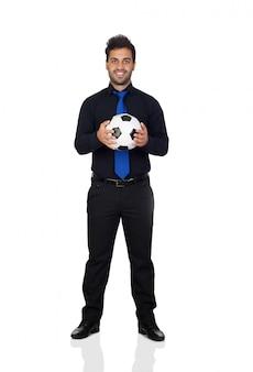 흰색 배경에 고립 된 공을 세련 된 축구 선수
