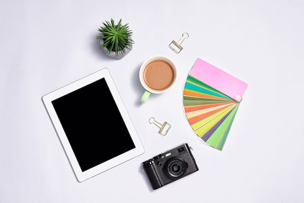 Stylish stationery with laptop on color background