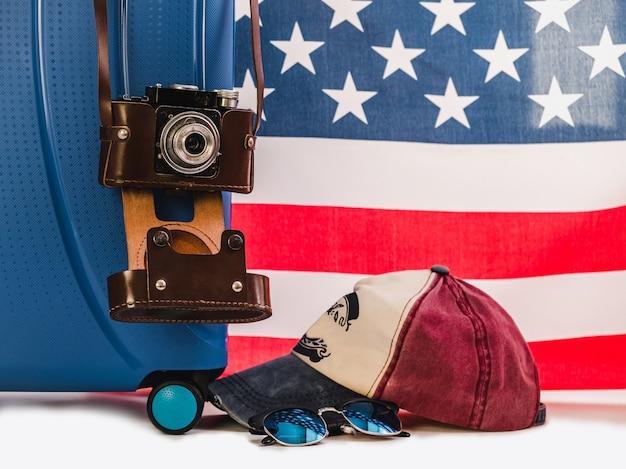 Stylish suitcase, us flag on a white background Premium Photo