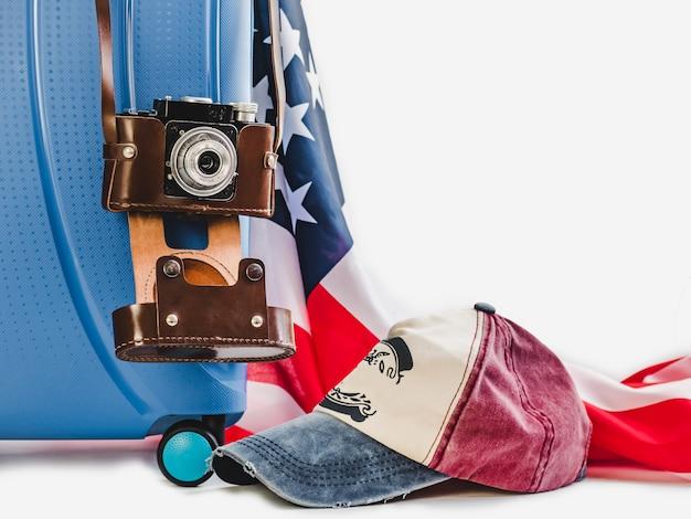 Stylish suitcase, usa flag and vintage camera