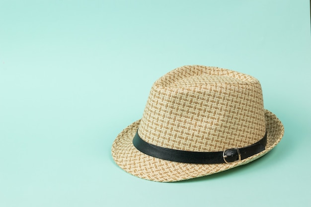 Stylish summer men's hat with a strap on a blue background. classic men's headdress.