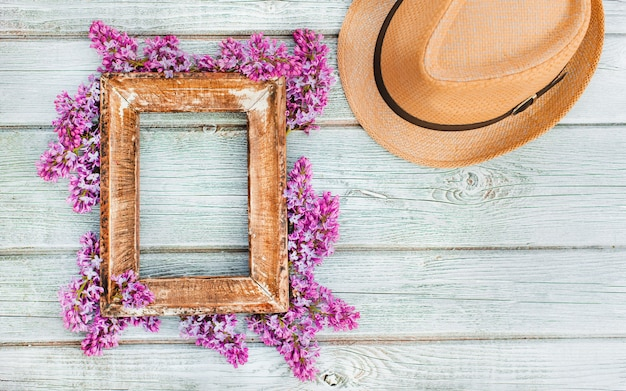 Stylish summer spring composition with vintage photo frame and hat