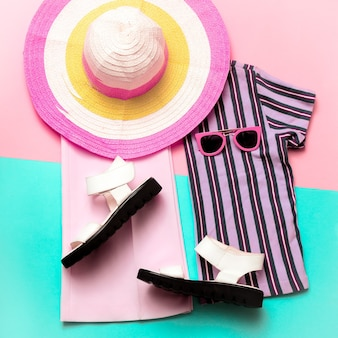 Stylish summer women's clothing and accessories. beach fashion. trend strip print. bright outfit
