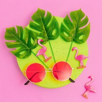 Stylish sunglasses in tropical composition. minimal fashion flat lay art