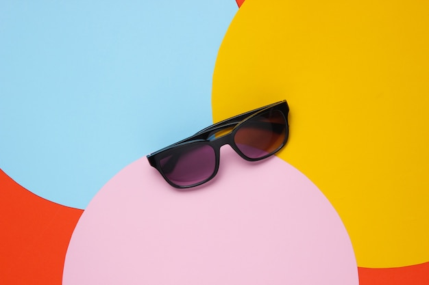 Stylish sunglasses on with colored paper circles