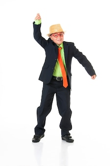 Stylish teenager in hat dancing on white background.