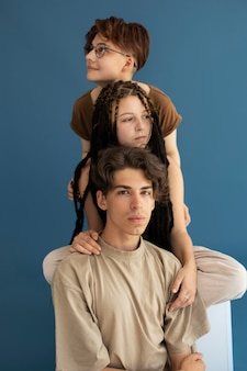 Stylish teenagers posing together