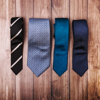 Stylish ties on wooden table