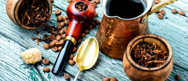 Stylish tobacco pipe with tobacco and brewed coffee