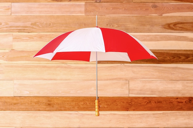 Stylish umbrella on wooden