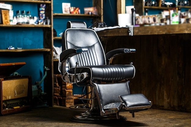 Stylish vintage barber chair. barbershop theme. professional hairstylist in barbershop interior.