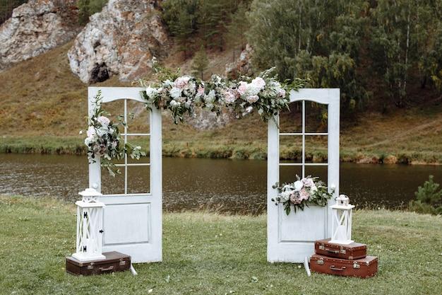 Stylish wedding arch with fresh flowers