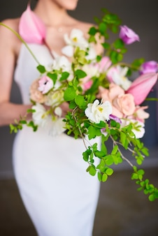 Stylish wedding bouquet in the hands of the bride