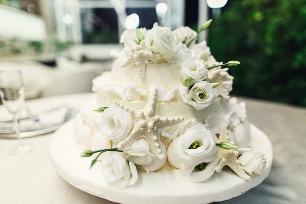 Stylish wedding cake decorated with silver seastars