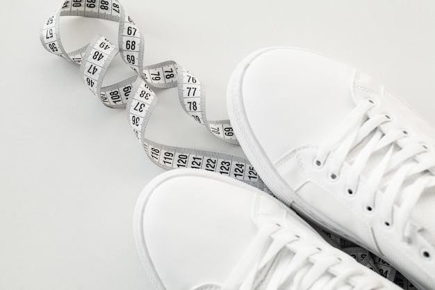 Stylish white fashion sneakers on white .