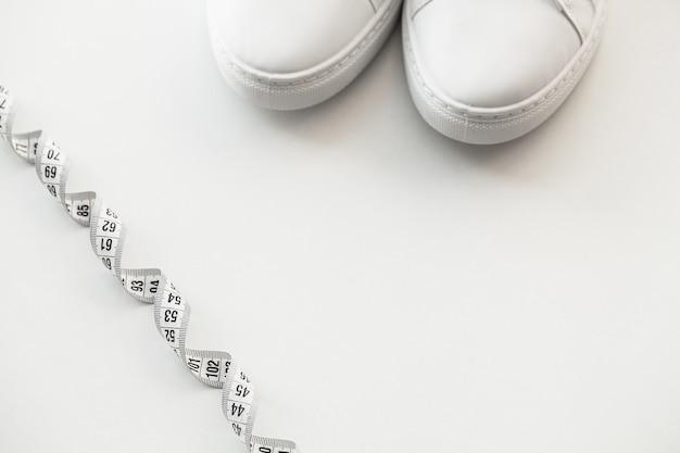 Stylish white fashion sneakers on white