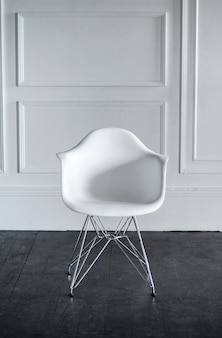 Stylish white modern chair on a light background
