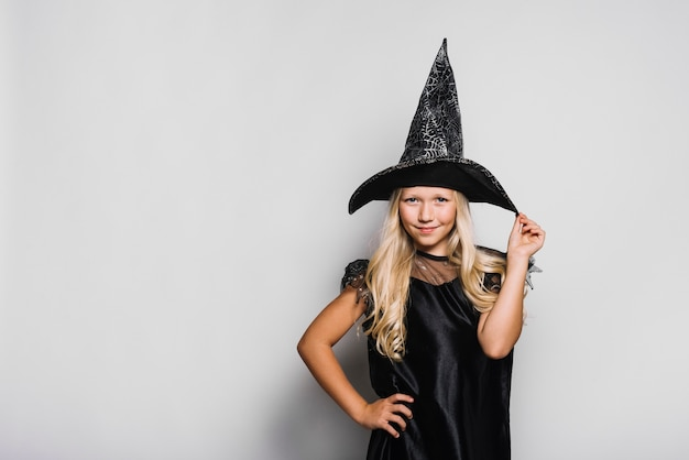 Stylish witch looking at camera