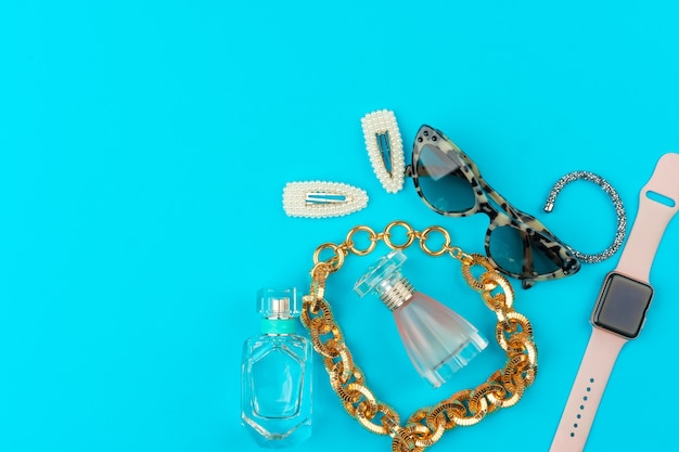 Stylish woman accessories on bright background close up