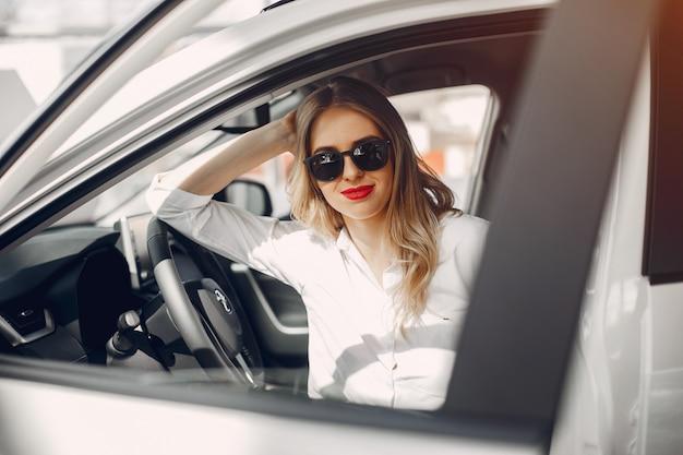 Stylish woman in a car salon