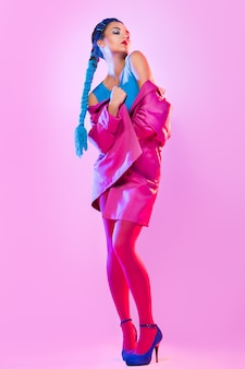 Stylish woman in pink and blue clothes