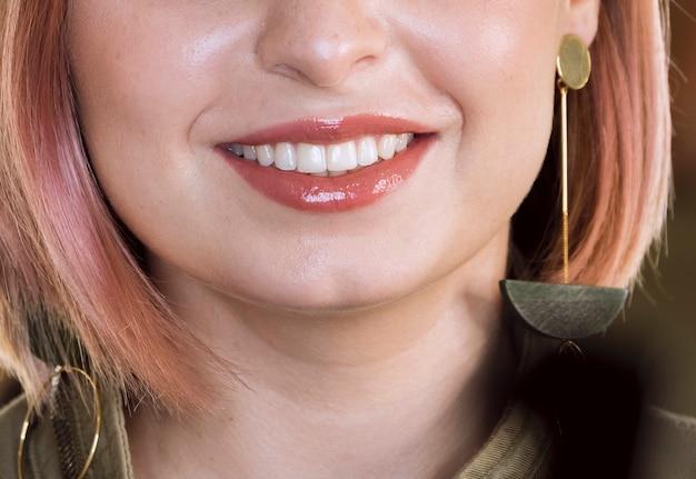 Stylish woman smiling close up