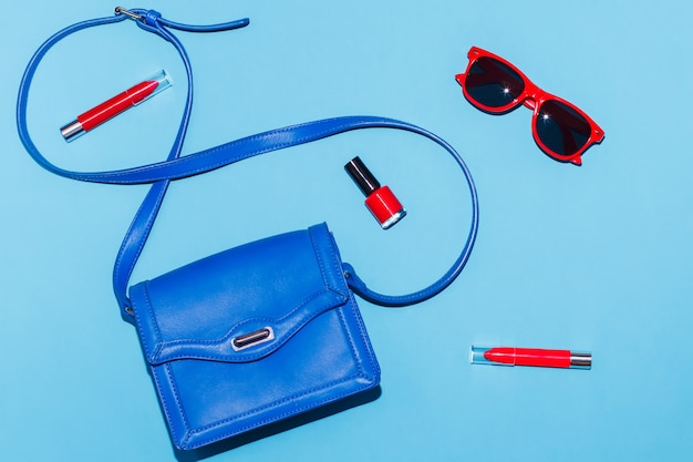 Stylish woman summer accessories in red and blue colors