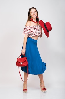 Stylish woman in summer outfit isolated posing in fashion trend isolated