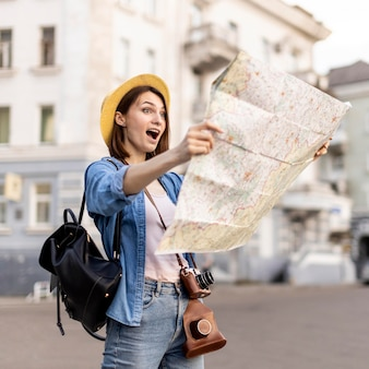 Stylish woman surprised of local sightseeing spots