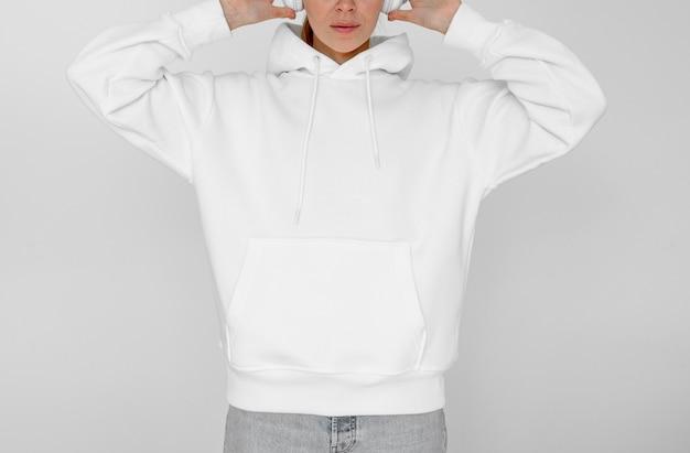 Stylish woman wearing a white hoodie