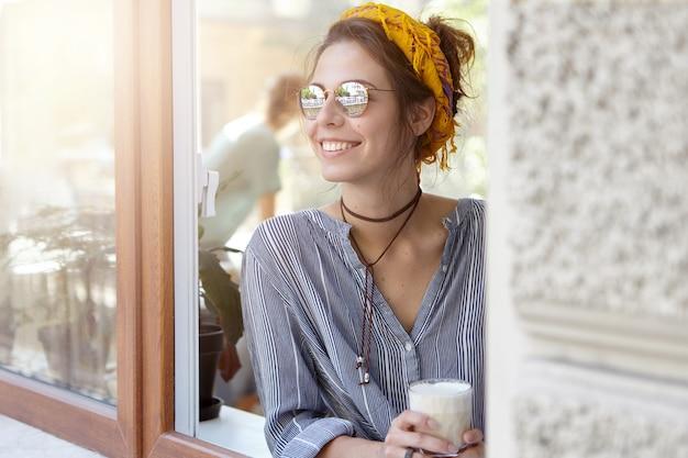 Stylish woman wearing yellow bandana