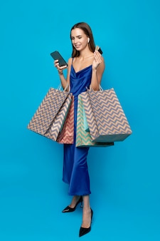 Stylish woman with shopping bags
