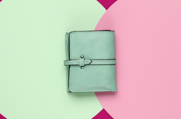 Stylish women's leather wallet on colored background