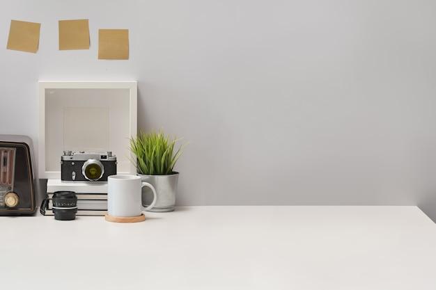 Stylish workplace desk vintage camera