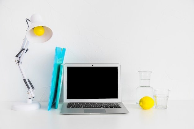 Stylish workplace with blue files andlemon