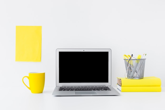 Stylish workplace with laptop and yellow details