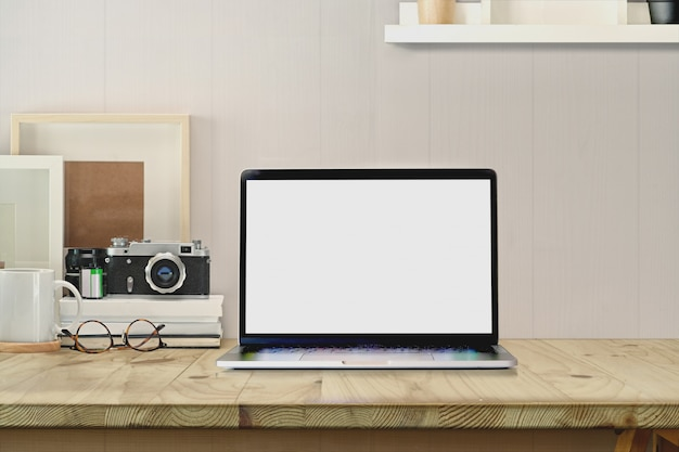 Stylish workspace with blank screen laptop