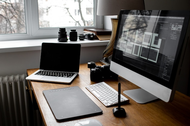 Stylish workspace with laptop on home or studio