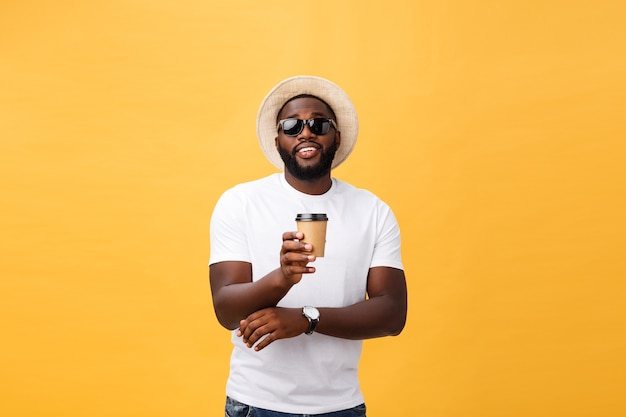 Stylish young african american man holding cup of take away coffee isolated