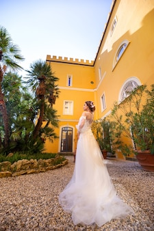 Stylish young bride on her wedding day in italy.elegant bride from tuscany.bride in a white wedding dress.