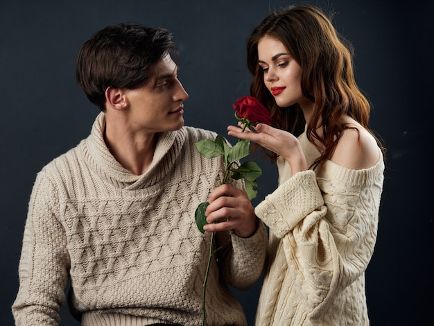 Stylish young couple man and woman, sexual relations, couple of models, dark surface