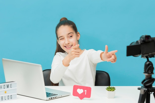 Stylish young girl recording video for blog