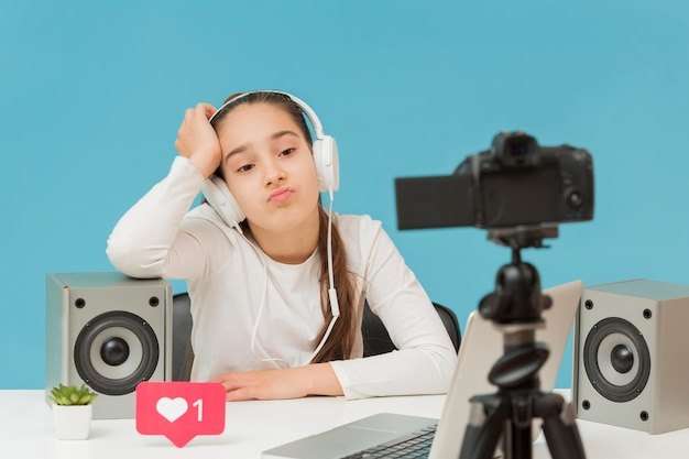 Stylish young girl recording video