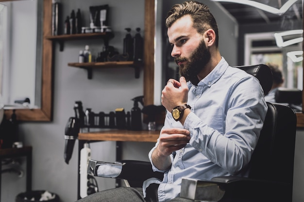 Stylish young man in barbershop