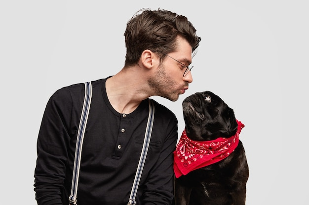 Stylish young man and his cute dog