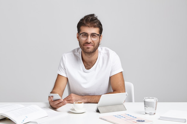 Stylish young man sitting at desk