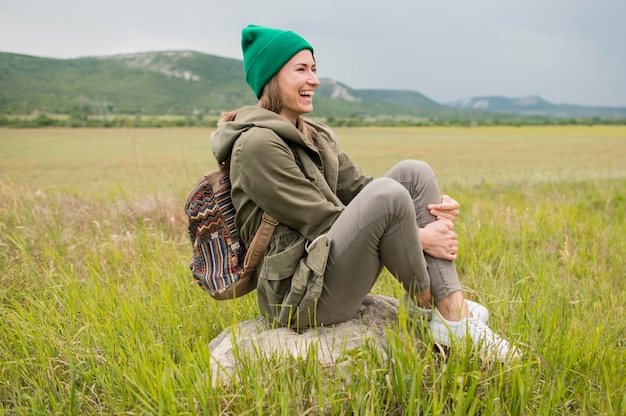 Stylish young traveller with beanie enjoying vacation