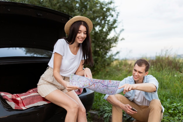 Stylish young woman checking local map with boyfriend
