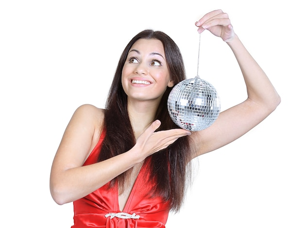 Stylish young woman with a mirror ball .photo with copy space